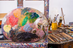 Palette in an atelier. Palette against the background of an artists atelier stock photo