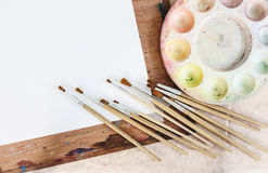 Palette with board and brush background Stock Photo