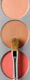 Palette of brown and terracotta eye shadow and makeup brush, top view Royalty Free Stock Images
