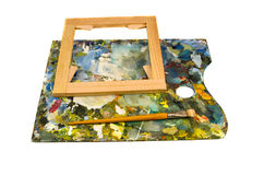 Palette with brush and canvas  frame Stock Photography