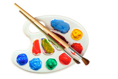 Palette with brushes isolated Royalty Free Stock Photos