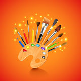 Palette and brushes on orange background Stock Photography