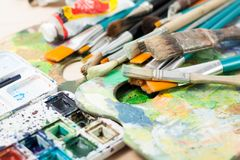 Palette and brushes. Palettes with brushes and box of watercolors royalty free stock image