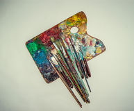 Palette and brushes yellow toned Royalty Free Stock Photography