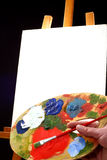 Palette,  canvas and easel Stock Image