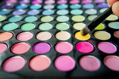 Palette of colorful eye shadows and make up brush Stock Photo