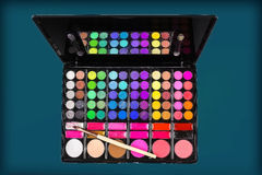Palette of colorful eye shadows and makeup brush Stock Images