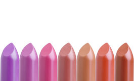 palette of colorful lipsticks in line assortment isolated on white  Stock Images