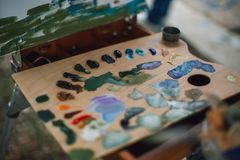 Palette with colorful oil paints stock images