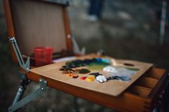 Palette with colorful oil paints stock photo