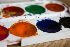 Palette of colorful watercolors close Stock Images