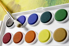 Palette with colors and brush Stock Image