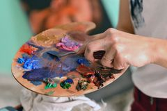 Wooden palette with oil paints stock photo