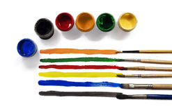 Palette colors and paints. Palette colors and opened paint buckets Royalty Free Stock Images