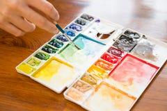 Palette de pinceau et de peinture Photos libres de droits