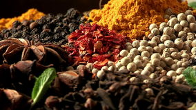 The palette of different food spices. Macro. stock footage
