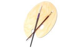 Palette et brosses en bois de peinture Image stock
