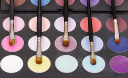 Palette eye shadow and cosmetic brushes for makeup. Stock Photography