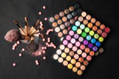 Palette of eyeshadows with brushes isolated on Royalty Free Stock Photo