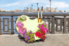The palette with flowers instead of paints in the Kremlin embankment of the river Kazanka. Stock Photos