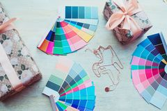 Palette and gifts on new year background. The work of a stylist. New year concept stock image