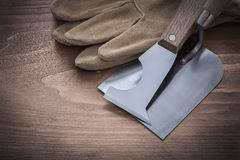 Palette knife bricklaying trowel and leather gloves close up vie Royalty Free Stock Photography