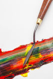 Palette knife and mixed oil paints on white canvas Royalty Free Stock Photography