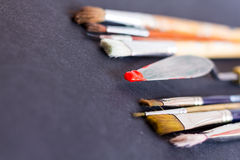 Palette Knife Spatula with Red Pigment. Palette Knife with Red Pigment Royalty Free Stock Photo