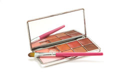 Palette of lipstick. Used lip palette and pink brush on white background royalty free stock photo