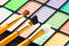 The palette for makeup. With three brushes Stock Images