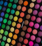 Palette of multicolor cosmetic make up, eye shadow palette, colorful shadows texture, round color circles, isolated on white backg. Round royalty free stock photo