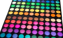 Palette of multicolor cosmetic make up, eye shadow palette, colorful shadows texture, round color circles, isolated on white backg. Round stock image