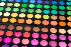 Palette of multicolor cosmetic make up, eye shadow palette, colorful shadows texture, round color circles, isolated on white backg. Round royalty free stock image