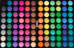 Palette of multicolor cosmetic make up, eye shadow palette, colorful shadows texture, round color circles, isolated on white backg. Round stock photo