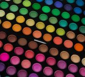 Palette of multicolor cosmetic make up, eye shadow palette, colorful shadows texture, round color circles, isolated on white backg. Round stock images