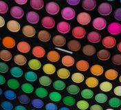 Palette of multicolor cosmetic make up, eye shadow palette, colorful shadows texture, round color circles, isolated on white backg. Round royalty free stock photography