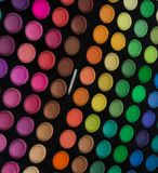 Palette of multicolor cosmetic make up, eye shadow palette, colorful shadows texture, round color circles, isolated on white backg. Round royalty free stock images