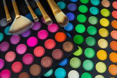 Palette of multicolor cosmetic make up, eye shadow palette, colorful shadows texture, round color circles, isolated on white backg. Round royalty free stock photos