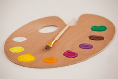 Palette with multiple colors and paint brush Stock Photo