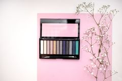 Palette of nude and bright cosmetic make up, eye shadow palette, natural colors shadows minimalism, top view stock photo