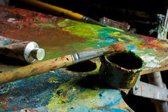Palette and oil Stock Images