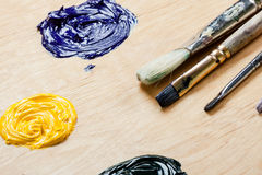 Palette with oil paint and brushes. Royalty Free Stock Images