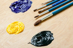 Palette with oil paint and brushes. Royalty Free Stock Image