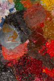 Palette with oil paint dried. Royalty Free Stock Photography
