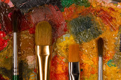 Palette with oil paint dried. Royalty Free Stock Photo