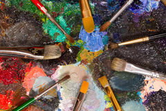 Palette with oil paint dried and  set of brushes Royalty Free Stock Photography