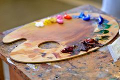 Palette with oil paints. Close up of different color oil paint stock photography