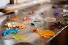 Palette of oil paints on glass Stock Images
