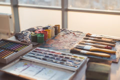 Palette with oil paints and gouache set. Clean painter workplace ready for drawing. Stock Images