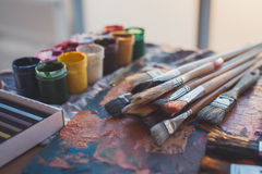 Palette with oil paints and gouache set. Clean painter workplace ready for drawing. Royalty Free Stock Photography